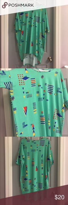 LuLaRoe Irma top Brand new, never worn medium size Irma in a teal color green with blue, red, and yellow designs. NWOT. LuLaRoe Tops Tunics