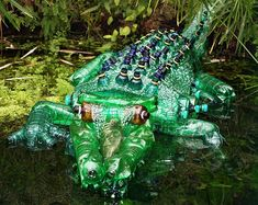 PET Crocodile    Crocodile made from PET bottles    A statue by Veronika Richterova made from plastic bottles. Taken on the PET TROPICANA exhibiton in the Prague Botanical Garden.  ww.flickr.com/photos/martinpilat/4351536823/in/pool-plastic#