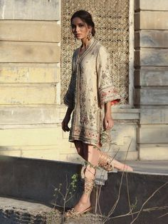 Our Alisha Kurti is inspired by the Kashmiri water gardens. It is styled with a shaded pistachio dhoti shalwar. Pink lamé-like tissue Shaded pistachio Kathan silk Dry clean. Pakistani Wedding Outfits, Pakistani Dresses, Indian Outfits, Misha Lakhani, Hijab Collection, Desi Wear, Desi Clothes, Indian Designer Wear, Shalwar Kameez