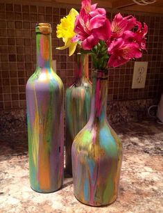 Wine bottle with interior lights. Can be painted with glass paint or custom order vinyl tie dye design. #paintedwinebottles #paintedwineglasses