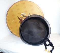 https://www.etsy.com/listing/244387381/vintage-hat-navy-blue-w-velvet-hatband?ref=shop_home_feat_1