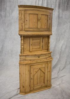 "Scandinavian 3-part scrubbed pine corner cabinet, each section with paneled doors, center section with full-turned spindles, 19th C, 80"" h"