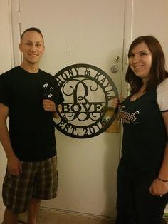 Newlyweds receiving a custom wedding/anniversary sign.