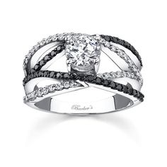 This unique black and white diamond engagement ring features a white gold split criss-crossing shank. A prong set round diamond center is cradled in the open center by four criss-cossing bands, two bands sport black diamonds, while the other two are adorned with white diamonds crossing over and under each other for a dramatic latticework effect that is nothing short of spectacular. <br /> <br /> Also available in 18k and Platinum.