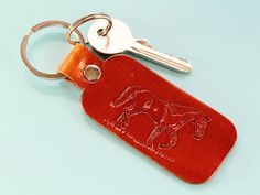 This hand-carved leather keyring would make an excellent leather gift. This leather keychain for women would also make an cute birthday gift for a friend. Leather Bookmark, Leather Keyring, Leather Gifts, Leather Tooling, Leather Craft, Horse Gifts, Gifts For Horse Lovers, Leather Anniversary Gift, Cute Birthday Gift