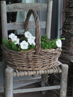 #weathered #chair, weathered #basket filled with flowers
