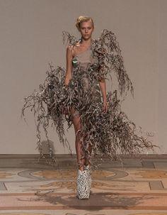http://www.dezeen.com/2013/07/02/3d-printed-shoes-by-iris-van-herpen-and-rem-d-koolhaas/