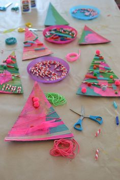 """These beautiful and original Christmas trees were made by the four-year olds in art class! Aren't they amazing? They loved learning the word """"assemblage"""", which"""