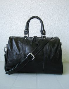 Leather duffle small black--handmade Leather bag Diaper bag Shoulder bag Tote Handbag Hip bag Women. $145.00, via Etsy.