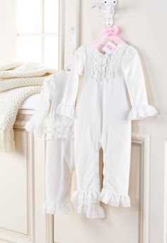 This simple yet elegant cream velour sleeper features ruffle accents and an inner leg snap closure. Add a pop of color to the baby sleeper with a bold, bright, dramatic headband from our selection of Mud Pie's hair accessories for irresistibly cute, lounging baby style. Fits size 0-6 months.