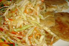 Curtido De Repollo - El Salvadorean Cabbage Salad from Food.com: This spicy Salvadoreno coleslaw is the traditional zesty topping for pupusas (thick corn tortillas stuffed with cheese). You can also try serving it with fish or black beans, inside burritos or on top of quesadillas.