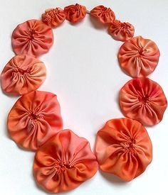 Suffolk puff (yo-yo) necklace, bamboo fibre dyed with Procion dye, hand sewn.    By Kirsty Basram