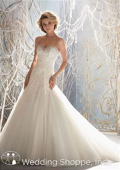 Stunning lace a-line wedding dress with sweetheart neckline.