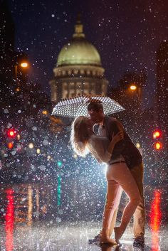 Wow! Super awesome rain engagement photo with the Wisconsin State Capitol! (Photo by Laura Zastrow Photography)