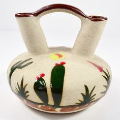 This beautiful clay piece boasts a traditional style with hand-painted detail for a one-of-a-kind display decorative vase. This vase is handcrafted by artisans in Mexico.