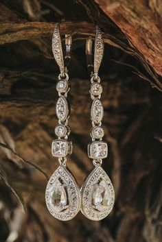 Stunning Teardrop Earrings   Vitaly M Photography   Black Tie Coastal Wedding with Classic Beach Details