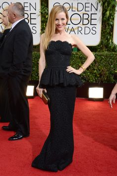 Actress Leslie Mann opted for a black, strapless Dolce & Gabbana dress.