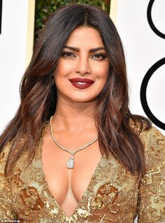 Berry beautiful! Priyanka Chopra, 34, opted for a jolt of color on her lips, courtesy of Stephanie Brooke Barnes, who mixedLaura Mercier Velour Lovers Lip Colour in An Affair and Seduction