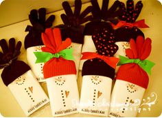 There is a link at this website to download snowman templates for a craft project such as this:  paper wrappers around microwave popcorn or a Hershey bar; the hat can be made from a pair of gloves!