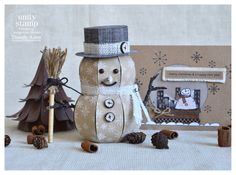 """Thienly's Snowman Box is made out of brown kraft paper and stamped with snowflakes!  She started a """"fad"""" with this one!  Adorable!!    He's in the CHRISTMAS OPEN HOUSE SVG KIT."""
