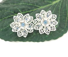 Vintage 1950s Snow White Enamel Blue Rhinestone Filigree Flower Clip-on Earrings by AVintageJewelryChest, $26.00