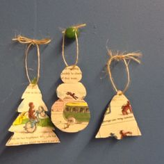 Ornaments from old children's books. I used Curious George.  Cut cardboard into desired shape. Glue on selected page and trim edges. Poke hole through the top, loop jute string through and tie.  Cute for the kids' tree!