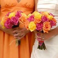 I'm doing an orange/coral wedding next week--planning on making it fun by adding in hot pink and yellow!