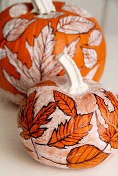 Sketchbook Pumpkins: Use a permanent marker to sketch on leaves. Once the surface is filled with leaves, use white acrylic paint to paint around the leaves so the leaves will pop in orange. While the paint is wet you can scratch into the surface to add texture.