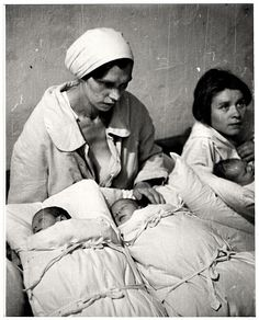 Two Polish mothers pose with their newborn infants during the siege of Warsaw. The twins pictured here died 5 years later from a shell blast in 1944, Julien Bryan, 1939.