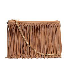 Shoulder bag in grained imitation leather with genuine suede fringe.