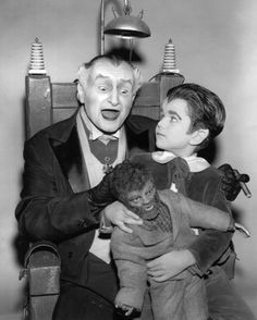 Munsters Grandpa and Eddie with Woof Woof the Wolfman doll relaxing in an electric chair.