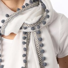 Ladies' White scarf with grey border and pom poms, by Style Slice, features a boho edge of pleated ribbon and grey pom poms. Elegant spring or summer shawl that can be personalised with a charm or a monogram. Suitable as a gift for anniversary, birthday or any day in which to tell the woman in your life, be it a Mum, Wife, Sister or Girlfriend, that she is special. #scarf #shawl #wrap #scarves #fashion #vintage #handmade #acessories #etsy #gift #pompom #headwrap #ootd #hippie #boho