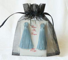 Baby blue long tassel ear plugs Breakfast at Tiffanys style. €12.50, via Etsy.