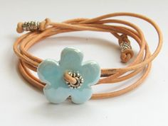 Cute leather wrap bracelet with ceramic flower Urban Jewelry, Diy Jewelry, Jewelery, Jewelry Bracelets, Handmade Jewelry, Jewelry Design, Jewelry Making, Ceramic Jewelry, Enamel Jewelry