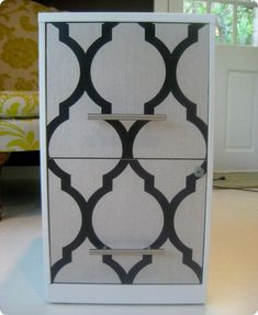 Wallpaper or fabric over file cabinet drawers--a fun way to jazz up that Executive Board