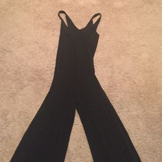 Norma Kamali cross back jumpsuit Super cute Kamali kulture cross back jumpsuit.  Never worn...super cute but a little too form fitting for me Norma Kamali Pants Jumpsuits & Rompers