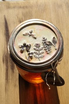 611 - very cool site! Embellished canning jar lid using UTEE in melting pot. It looks embossed, but it's charms!
