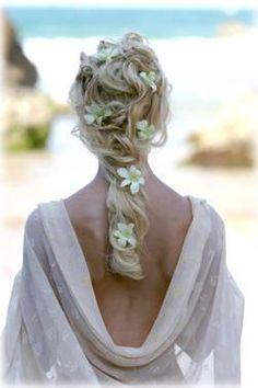 romantic frangipane braided into hair