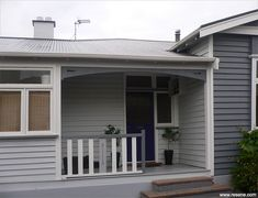 Exterior repaint with bold colours of Resene Iron with feature walls in Resene Shuttle Grey