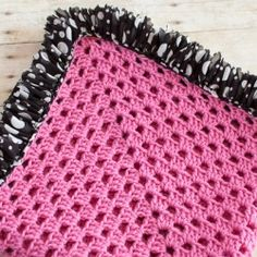 Jazz up your next blanket with a fun ruffle edge of fabric yarn.