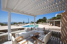 Mykonos pool villa with stunning sea views. Elegant holiday home with BBQ and shadded outdoors dining and seating areas. A celebration of life. Mykonos, Greece, Pergola, Bbq, Villa, Outdoor Structures, Outdoor Decor, Home Decor, Greece Country