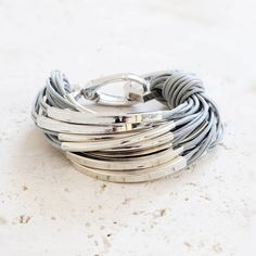 I've just found Katia Silver And Thread Bracelet. A statement bracelet made of coloured reinforced cotton strands onto which are threaded polished decorative tubes, knotted to a solid compact silver plated clasp. Thread Bracelets, Silver Bracelets, Bangle Bracelets, Silver Jewelry, Bangles, Women's Jewelry, Silver Rings, Fine Jewelry, Jewellery Sale