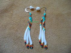Native American Style Dentillium Fringe earrings in Turquoise Green from Debs Visions. Saved to beadwork.