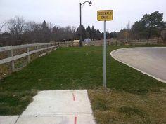 Abruptly.  |Sidewalk ends sign | Turn around |