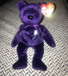 Princess Diana TY Beanie Baby. 1997 rare. Condition is Used. Like new. Originally purchased for collecting, not as a toy. P.E. Pellets. Like an angel, she came from heaven above She shared her compassion, her pain, her love She only stayed with us long enough to teach The world to share, to give, Princess Diana Beanie Baby, Ty Beanie, Dinosaur Stuffed Animal, Childhood, Teddy Bear, Compassion, Toys, Heaven, Handmade Gifts