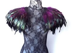 These statement feather epaulettes are an outstanding, versatile, quality accessory perfect for festivals like Burning Man, evening and occasion wear. This is a unisex design, custom made to order that compliments both the male and female form. This is a unique design, custom made from