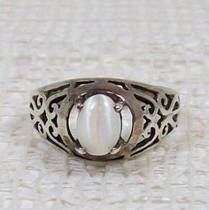 #HiddenRidgeRoadGifts on Artfire                    #ring                     #Sterling #Silver #Filigree #Ring #with #White #Cat's #Bead                   Sterling Silver Filigree Ring with White Cat's Eye Bead                                                 http://www.seapai.com/product.aspx?PID=211557