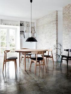 Urban rustic; stained concrete, exposed brick, clean lines, white, lots of natural light.