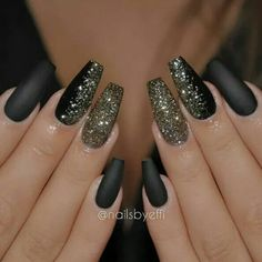 Black matte nail polish with gold glitter accents