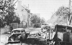 Destroyed German vehicles in Avranches, France, liberated by the US First Army on 30 July 1944. (US Center of Military History)